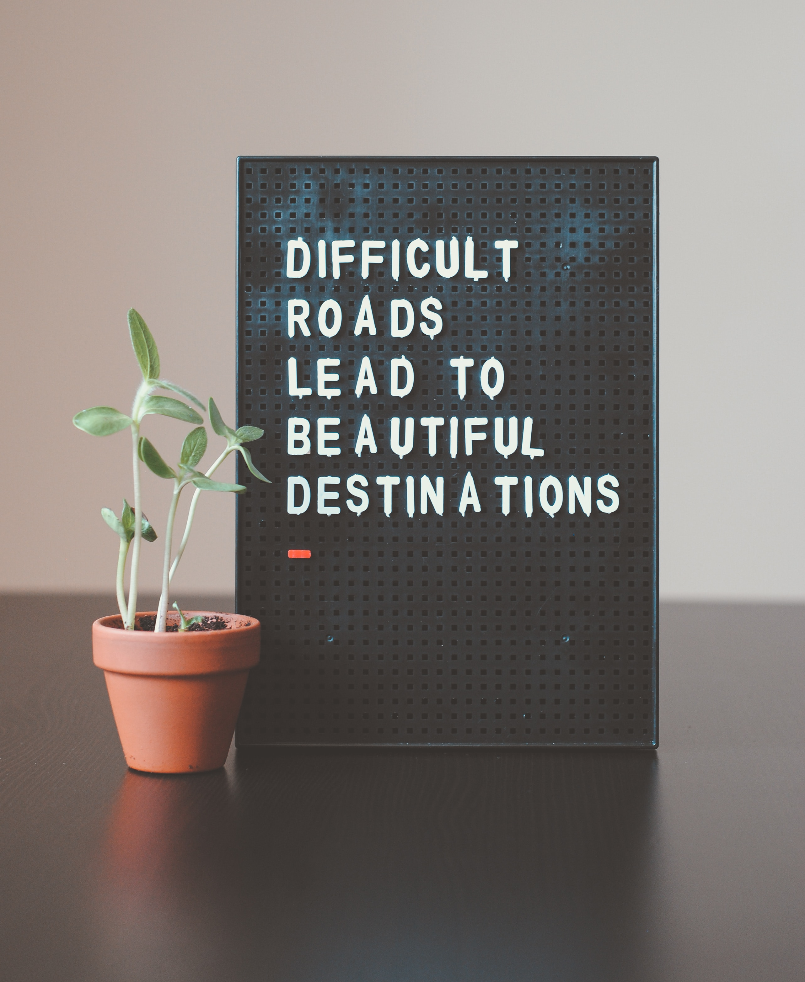 letter board that says difficult roads lead to beautiful things representing the joy you may feel after therapy in marietta, ga